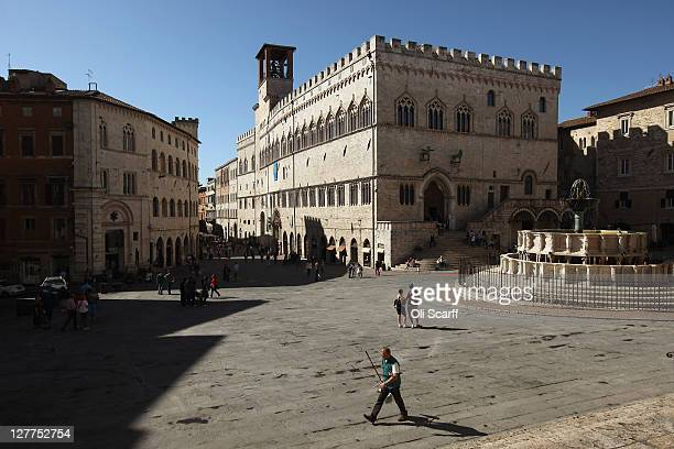 Members of the public walk through the Palazzo dei Priori in the city of Perugia the capital of the central Italian region of Umbria on October 01...