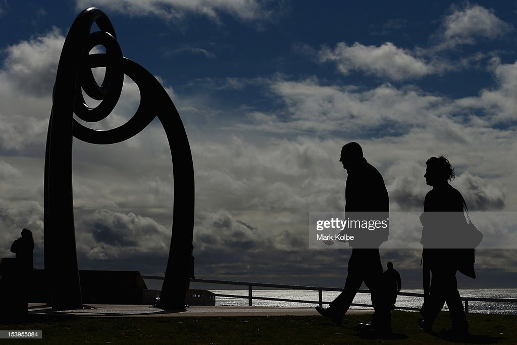 Members of the public walk towards the Bali memorial to lay flowers at a memorial ceremony at Dolphin Point in Coogee in on October 12, 2012 in Sydney, Australia. The ceremony marks tenth anniversary of the 2002 Bali suicide bombs that killed 202 people including 88 Australians.