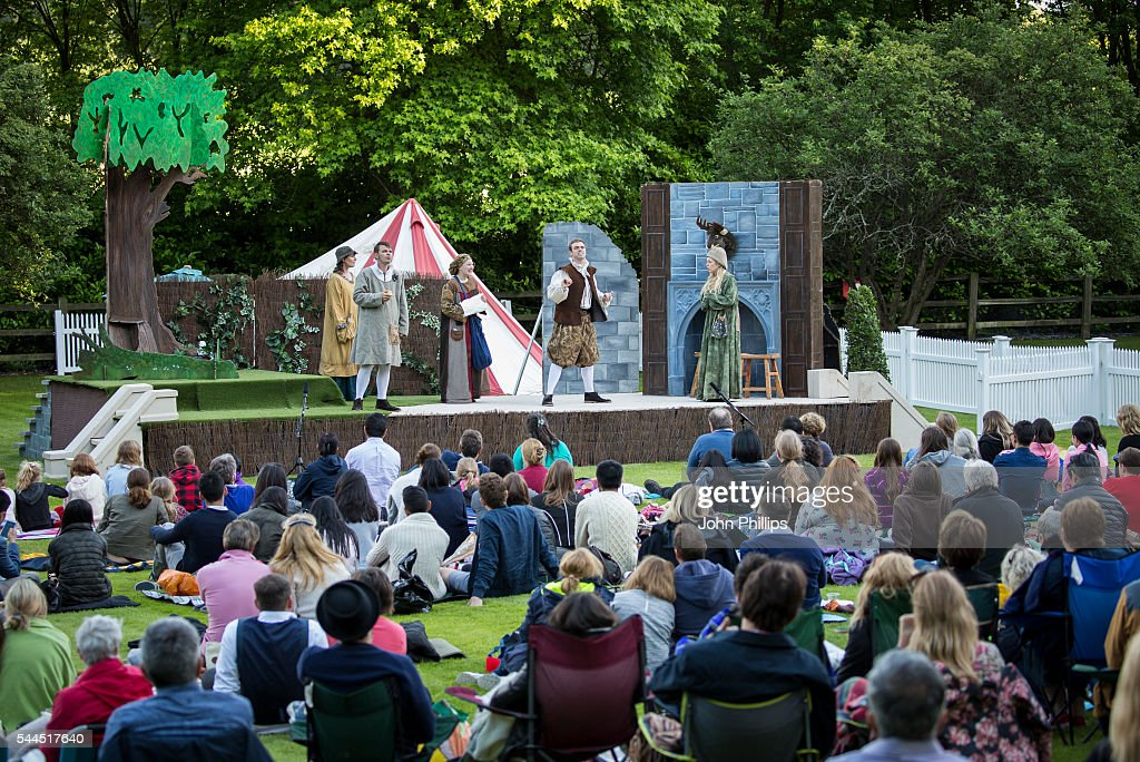 Members of the public watch a rendition of 'A Midsummer Night's Dream' at Ascot's Shakespeare Outdoor Theatre Production By Chapterhouse Theatre...