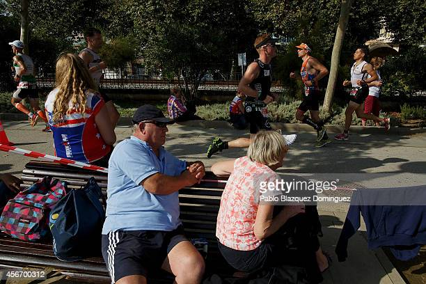 Members of the public watch athletes compete during the run section of Ironman Barcelona on October 5 2014 in Calella city near Barcelona Spain