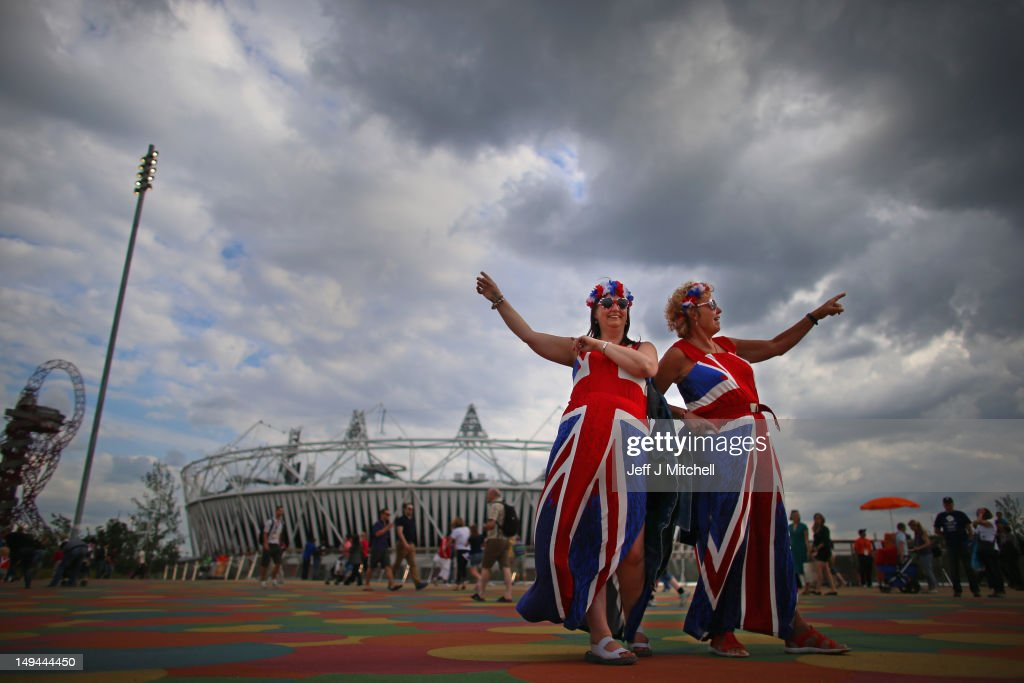 Members of the public wearing Union Jack clothing arrive on day one of the London 2012 Olympic Games at the Olympic Park on July 28, 2012 in London, England.