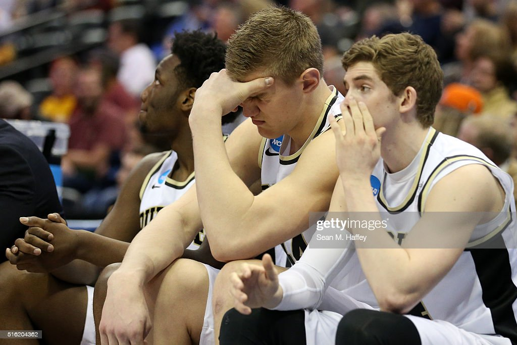 Members of the Purdue Boilermakers react at the end of regulation against the Arkansas Little Rock Trojans as the game goes into overtime during the...