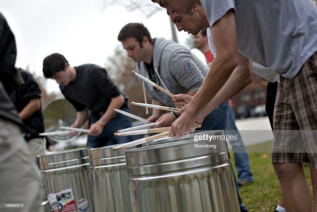 Members of the Purdue Drumline practice a routine using garbage cans in place of traditional drums on the campus of Purdue University in West Lafayette, Indiana, U.S., on Monday, Oct. 22, 2012. Administrative costs on college campuses are soaring, crowding out instruction at a time of skyrocketing tuition and $1 trillion in outstanding student loans. At Purdue and other U.S. college campuses, bureaucratic growth is pitting professors against administrators and sparking complaints that tight budgets could be spent more efficiently. Photographer: Daniel Acker/Bloomberg via Getty Images