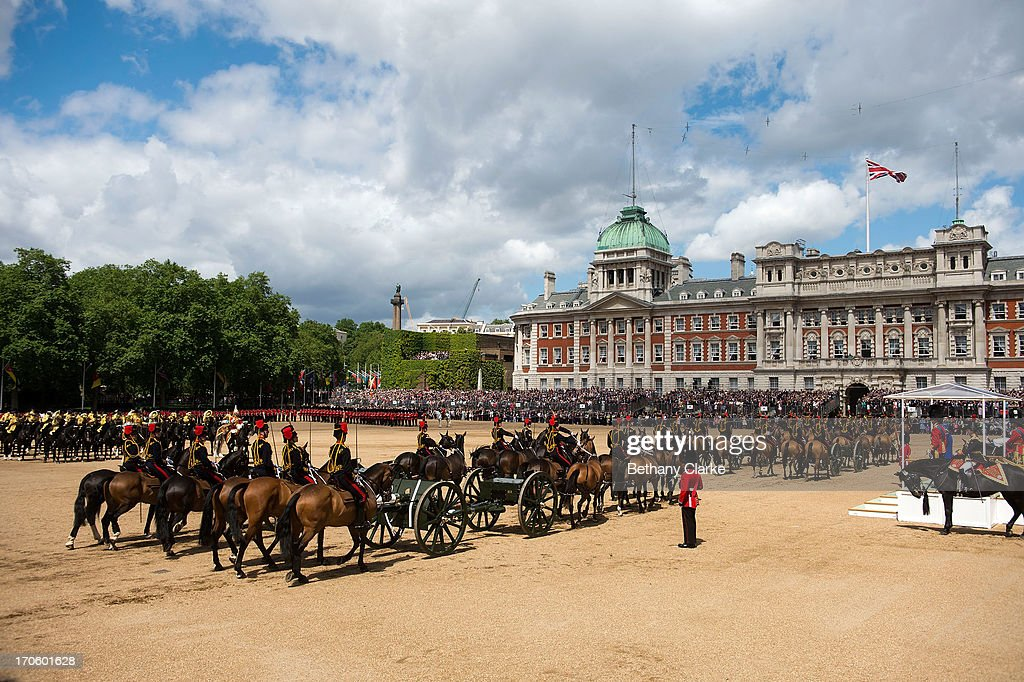Members of the Queen's Guard and the Household Cavalry march during the Trooping Of The Colour at Horse Guards Parade on June 15, 2013 in London, England. Today's ceremony which marks the Queens official birthday will not be attended by Prince Philip the Duke of Edinburgh as he recuperates from abdominal surgery and will also be The Duchess of Cambridge's last public engagement before her baby is due to be born next month.