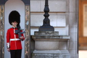 Members of the Queen's Guard perform the 'Changing of the Guard' ceremony at Buckingham Palace on April 8 2011 in London England The event which is...