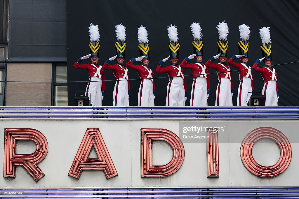 Members of the 'Radio City Rockettes' perform during their annual 'Christmas in August' event on top of the marquee of Radio City Music Hall on 6th...