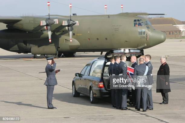 Members of the RAF Regiment carry the coffin of Flt Lt Andrew Smith to a hearse as it is returned to the UK He was one of ten servicemen killed when...