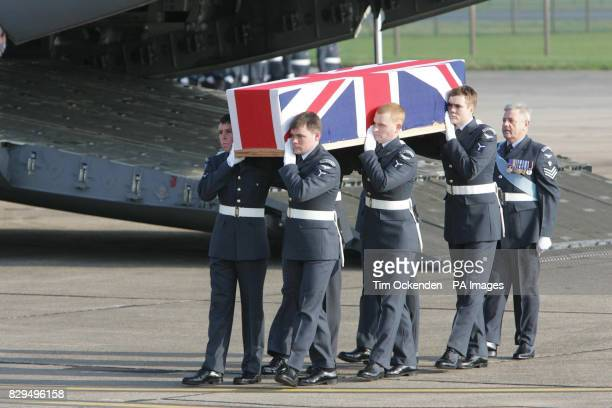 Members of the RAF Regiment carry the coffin of Flt Lt David Stead as it is returned to the UK He was one of ten servicemen killed when the C130...