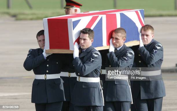Members of the RAF Regiment carry the coffin of Flt Lt Paul Pardoel as it is returned to the UK He was one of ten servicemen killed when the C130...