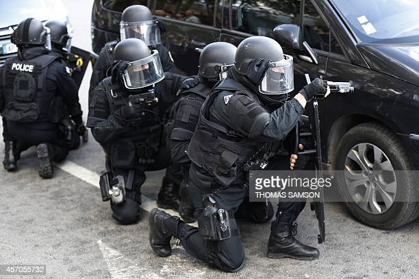 Members of the RAID the French national police intervention group take part in a public exercise in front of the Chateau de Versailles outside Paris...