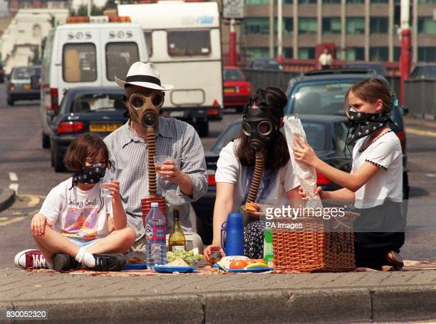 Members of the Ramblers' Association demonstrate what the 'picnic of the future' could be as they don World War I gas masks during a picnic on a...