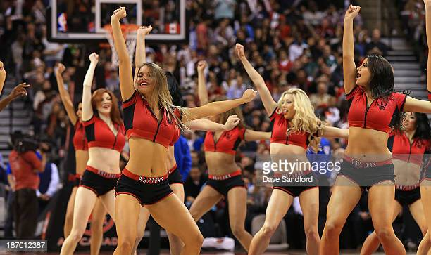 Members of the Raptors Dance Pak perform as the Boston Celtics face the Toronto Raptors during their NBA game at the Air Canada Centre on October 30...