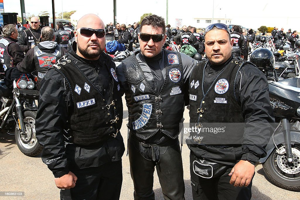 Members of the Rebels motorcycle club pose for a photo during a regroup at the Tammin roadhouse onroute to Perth on September 12, 2013 in Perth, Australia. An estimated 1000 Rebels from chapters all over Australia gather for the road trip across the country to Perth.
