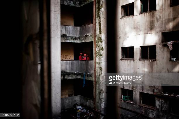 Members of the Red Ants a municipal team tasked with evictions are seen during evictions inside the Fattis Mansion in downtown Johannesburg on July...