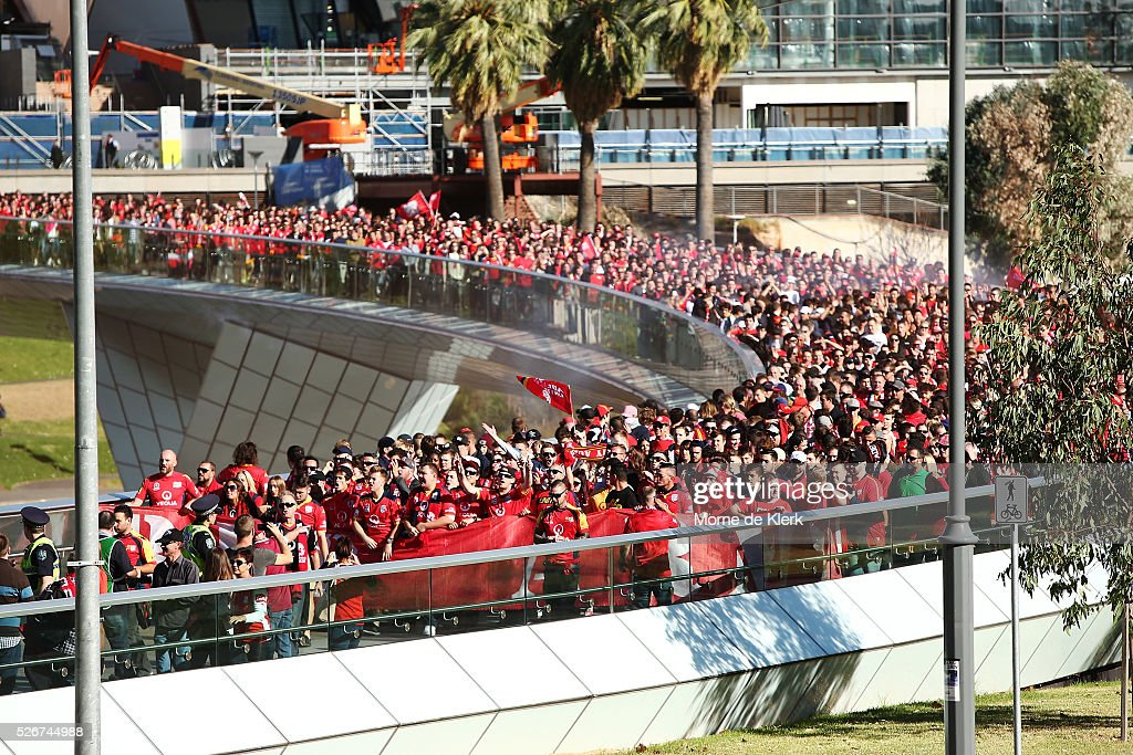 Members of the Red Army arrive at the Adelaide Oval before the 2015/16 A-League Grand Final match between Adelaide United and the Western Sydney Wanderers at the Adelaide Oval on May 1, 2016 in Adelaide, Australia.
