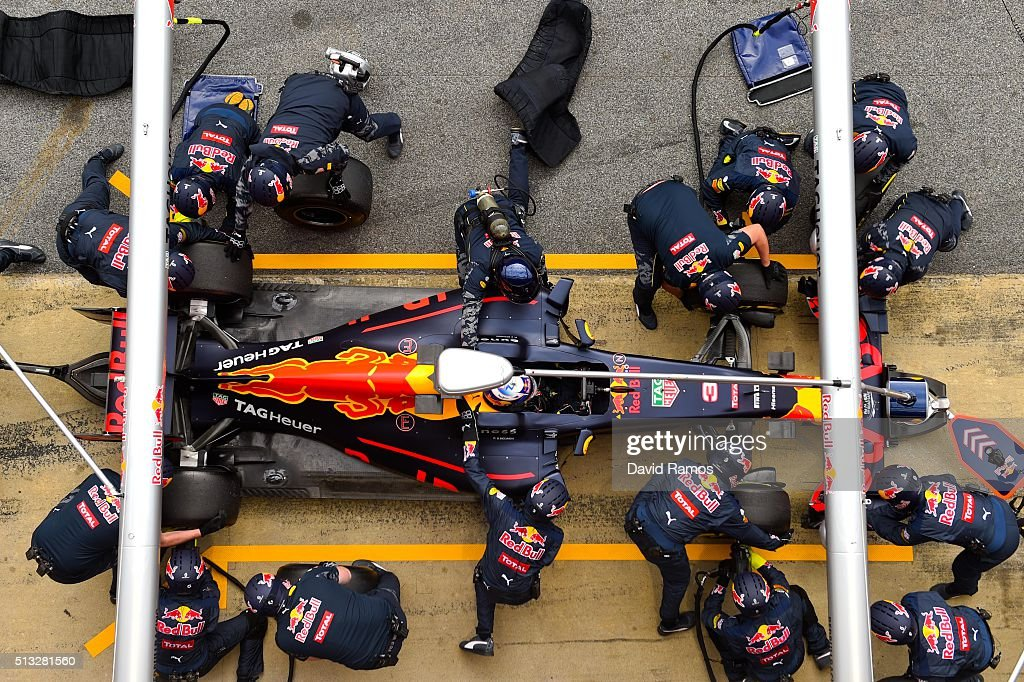 Members of the Red Bull Racing team take part in a pit stop practice session during day two of F1 winter testing at Circuit de Catalunya on March 2, 2016 in Montmelo, Spain.