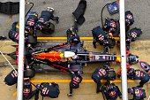 Members of the Red Bull Racing team take part in a pit stop practice session during day two of F1 winter testing at Circuit de Catalunya on March 2...