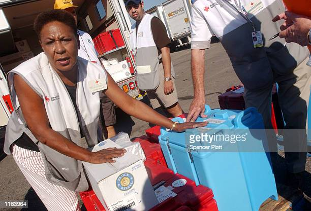 Members of the Red Cross and the Southern Baptist Convention Disaster Relief team move food onto trucks for WTC rescue workers September 19 2001 in...