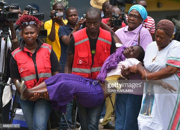 Members of the Red Cross carry a relative of one of the students massacred by Somalia's Shebab Islamists at a Kenyan university at the Chiromo...