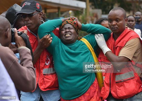 Members of the Red Cross help a relative of one of the students massacred by Somalia's Shebab Islamists at a Kenyan university at the Chiromo funeral...