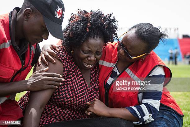 Members of the Red Cross help a woman overcome with grief after learning that a relative was killed by Somalia's Shebab Islamists during the siege on...