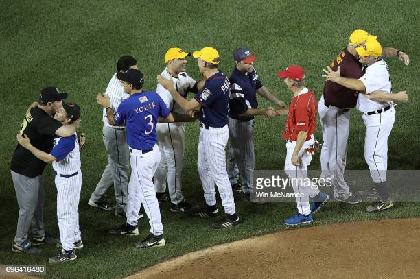 Members of the Republican and Democratic congressional baseball teams hug one another after the Congressional Baseball Game at Nationals Park on June...