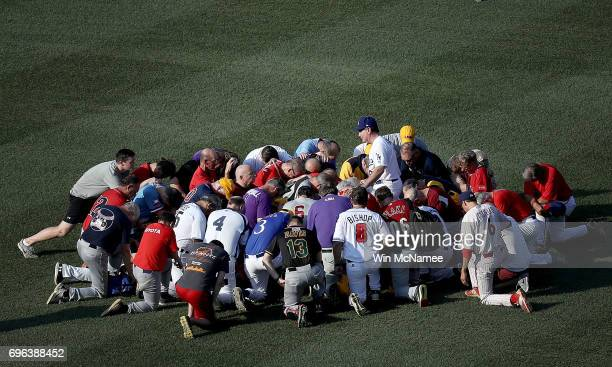 Members of the Republican congressional baseball team gather for a prayer before the start of the Congressional Baseball Game at Nationals Park on...
