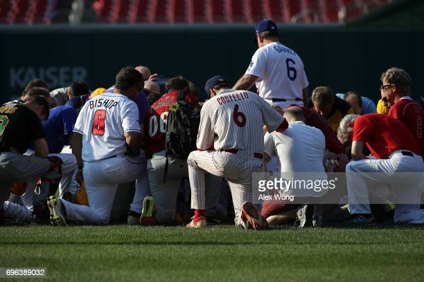 Members of the Republican congressional baseball team say a prayer prior to the 56th Annual Congressional Baseball Game for Charity at the National...