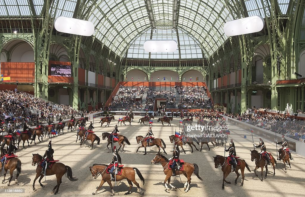 Members of the Republican Guard Cavalry Regiment perform during the Saut Hermes at the Grand Palais on April 17 2011 in ParisFrance