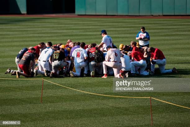 Members of the Republican team say a prayer before the Congressional Baseball Game between Democrats and Republicans at Nationals Stadium June 15...