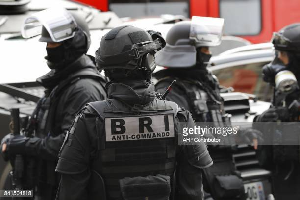 Members of the Research and Intervention Brigade of the French national police stand during a visit of French Interior Minister to the Paris Police...