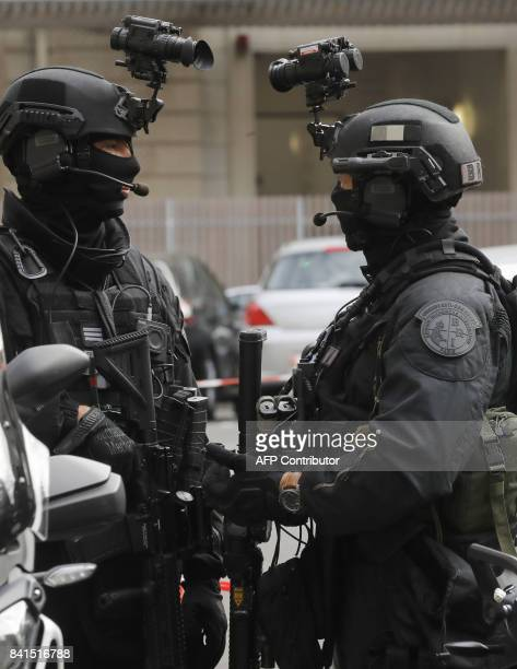 Members of the Research and Intervention Brigade of the French national police wearing nightvision goggles stand during a visit of French Interior...
