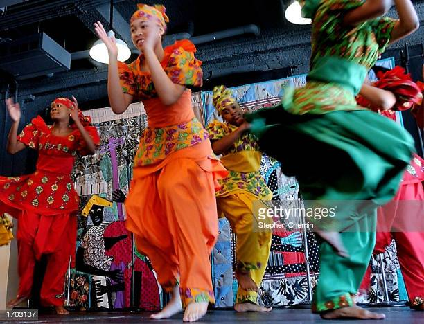 Members of the Restoration Dance Company perform a traditional African dance during a Kwanzaa festival at the Museum of Natural History December 28...