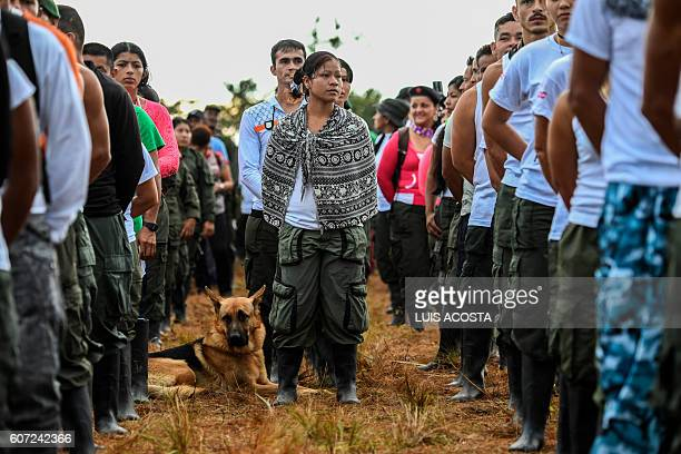 TOPSHOT Members of the Revolutionary Armed Forces of Colombia attend the opening ceremony of the September 1723 10th National Guerrilla Conference at...