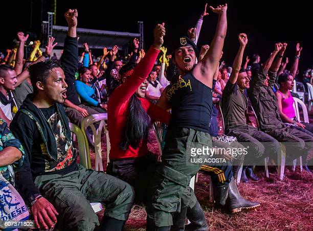 TOPSHOT Members of the Revolutionary Armed Forces of Colombia cheer as they attend a Cultural event during the 10th National Guerrilla Conference in...
