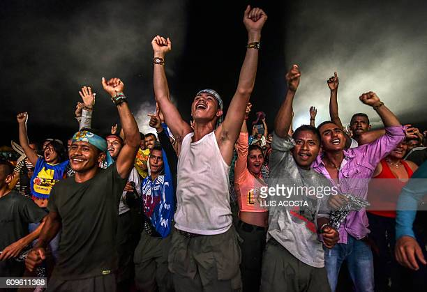 TOPSHOT Members of the Revolutionary Armed Forces of Colombia guerrilla dance during a cultural event held at their encampment in Llanos del Yari...