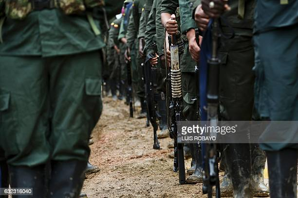 TOPSHOT Members of the Revolutionary Armed Forces of Colombia guerrillas are seen at the 'Alfonso Artiaga' Front 29 FARC encampment in a rural area...