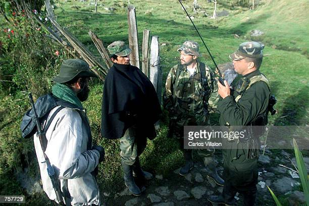 Members of the Revolutionary Armed Forces of Colombia listen to news from other FARC locations operating in the region April 7 2002 in Cundinamarca...