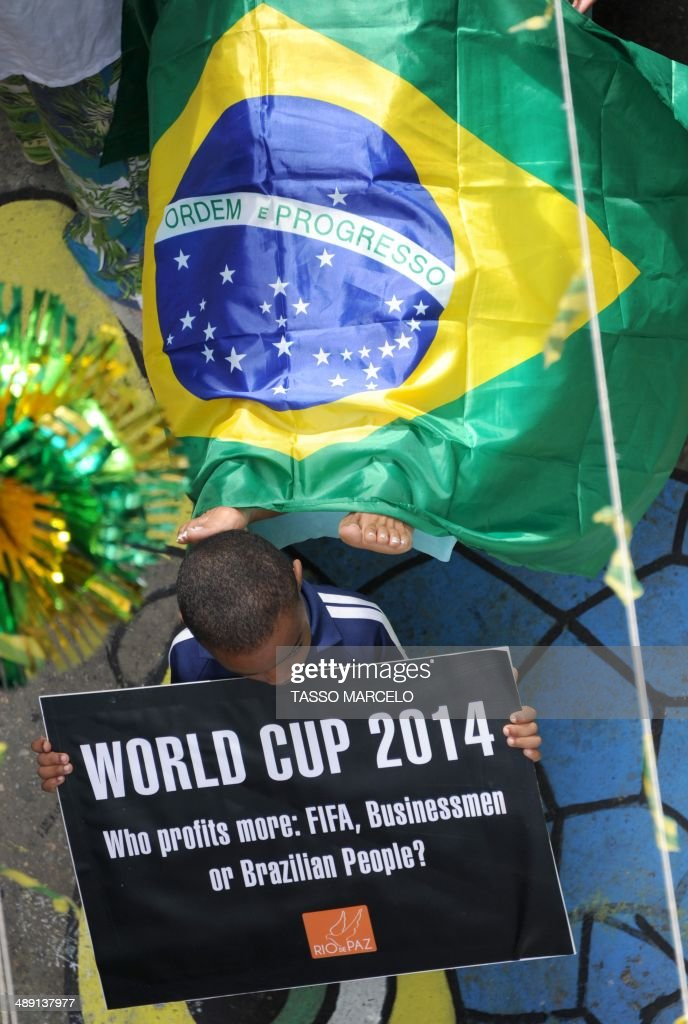 Members of the Rio de Paz NGO protest against problems with the public health care system at the same time as residents of the Jacarezinho shantytown decorated streets and houses of the neighborhood for the upcoming football world cup.