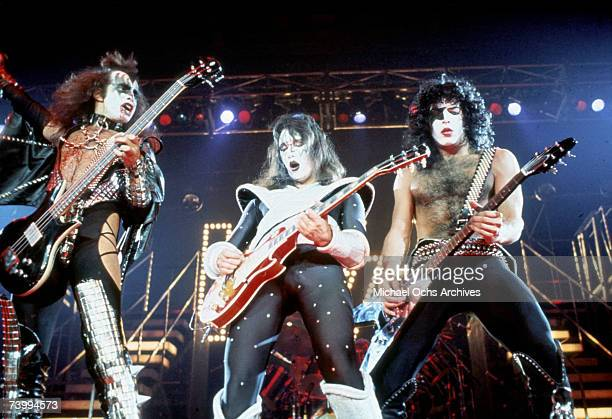 Members of the rock and roll band Kiss perform onstage in circa 1977
