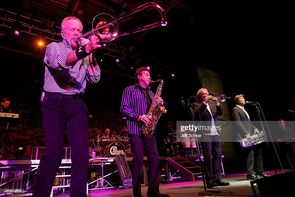 Members of the rock band Chicago James Pankow, Walter Parazaider, Lee Loughnane, Robert Lamm, and Jason Scheff perform during a free concert for those affected by the recent Illinois tornados at US Cellular Coliseum on January 29, 2014 in Bloomington, Illinois.