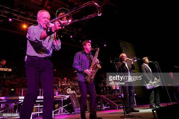 Members of the rock band Chicago James Pankow Walter Parazaider Lee Loughnane Robert Lamm and Jason Scheff perform during a free concert for those...