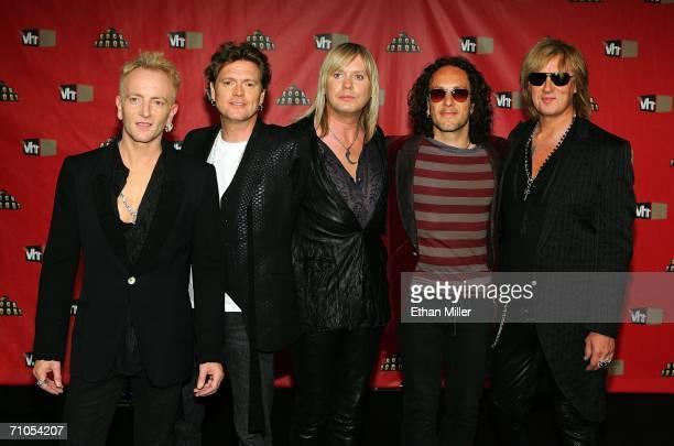Members of the rock band Def Leppard guitarist Phil Collen drummer Rick Allen bassist Rick Savage guitarist Vivian Campbell and singer Joe Elliott...
