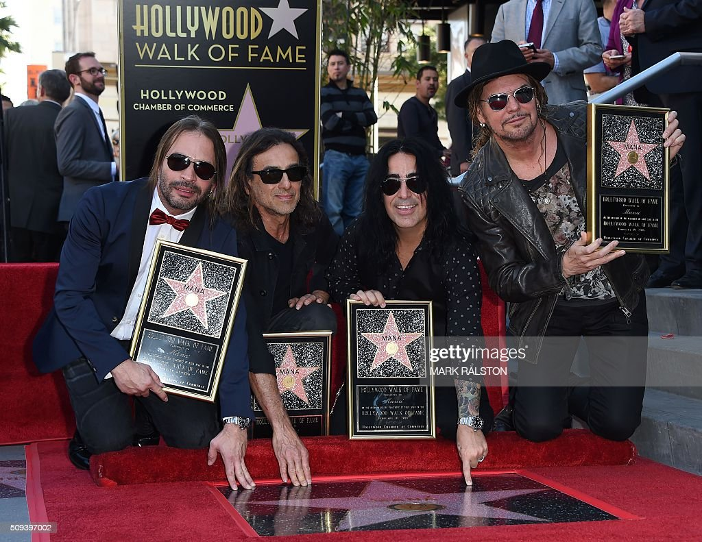Members of the rock band 'Mana' (L-R) Alex Gonzalez, Sergio Vallin, Juan Calleros and Fher Olvera at the ceremony honoring them with the 2,573rd star on the Hollywood Walk of Fame in Hollywood, California on February 10, 2016. / AFP / Mark Ralston