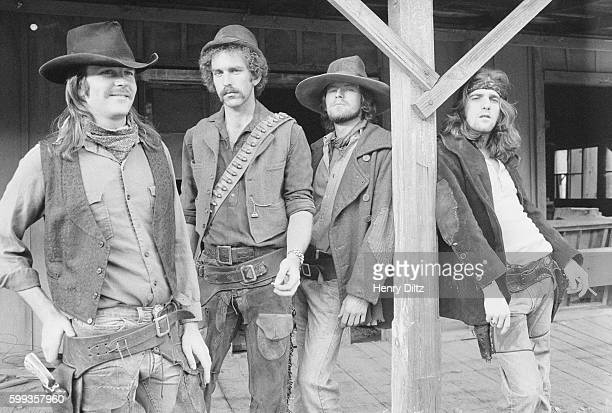 Members of the rock band The Eagles are dressed up in cowboy costumes for their Desperado album photo shoot From left to right Don Henley Bernie...