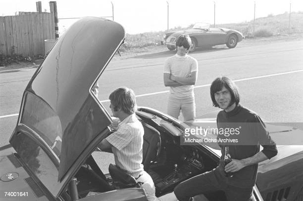 Members of the rock group 'Buffalo Springfield' take the top off of their Corvette on October 30 1967 in Malibu California Dewey Martin Richie Furay...