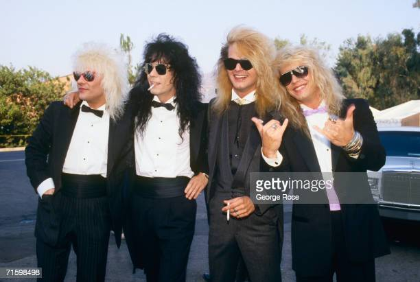 Members of the rock group Poison Bret Michaels CC DeVille Rikki Rockett and Bobby Dall pose on the red carpet at the 1987 Universal City California...