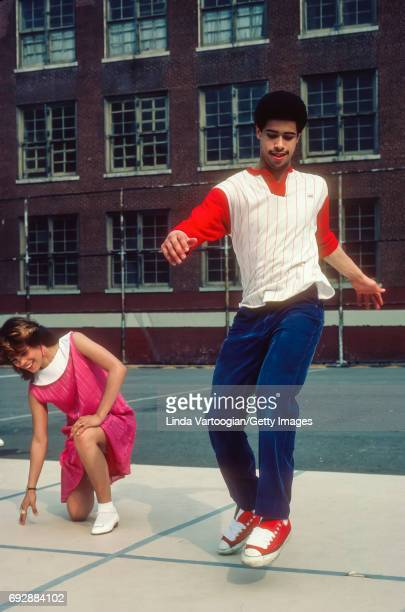 Members of the Rock Steady Crew including cofounder Richard 'Crazy Legs' Colon breakdance in the yard of Booker T Washington Junior High School New...