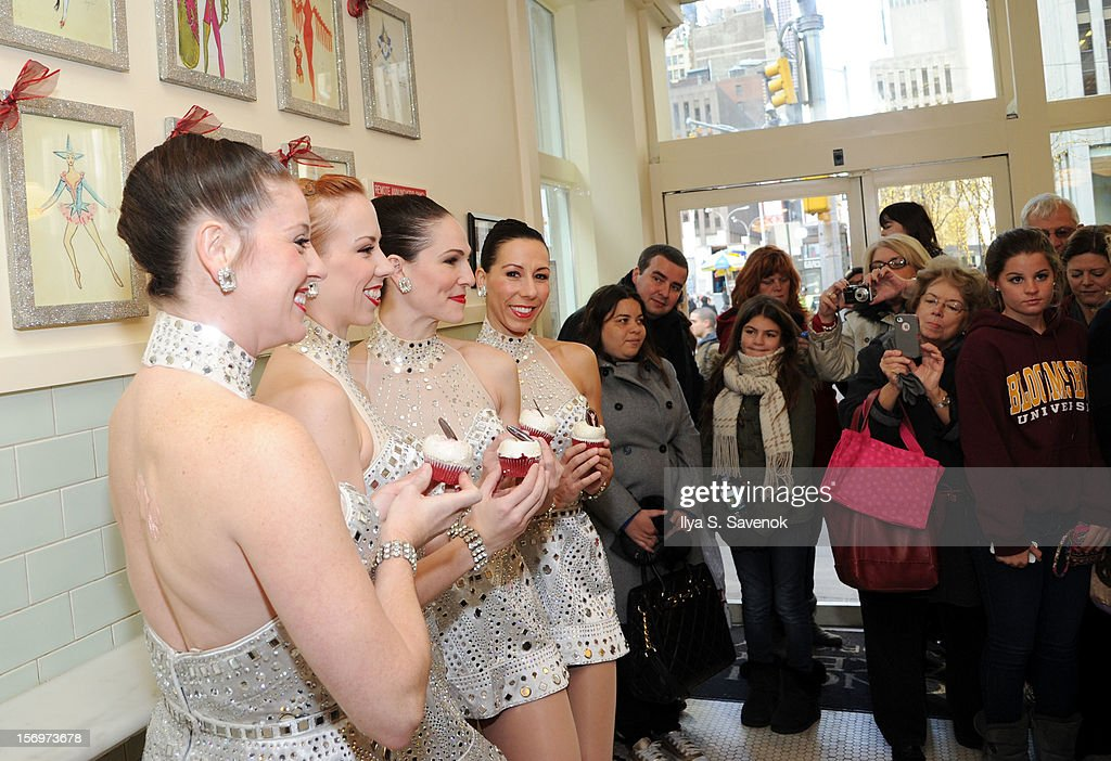 Members of the Rockettes attend the unveiling of the Magnolia Bakery Rockettes red velvet cupcake at Magnolia Bakery Rockefeller Center on November 26, 2012 in New York City.