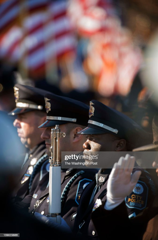 Members of the Rockville MD City Police Honor Guard stand at attention outside Hylton Memorial Chapel for the funeral service of Prince William County Police Officer Chris Yung on Friday, January 4, 2013.